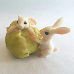bunnies rolling a cabbage