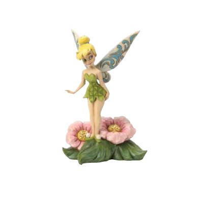 tinker bell standing on flower